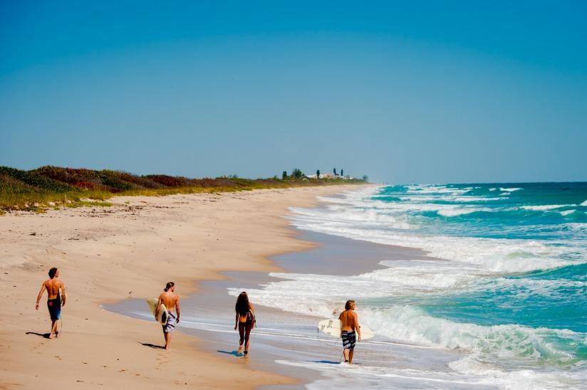 Beach Surfers Walking